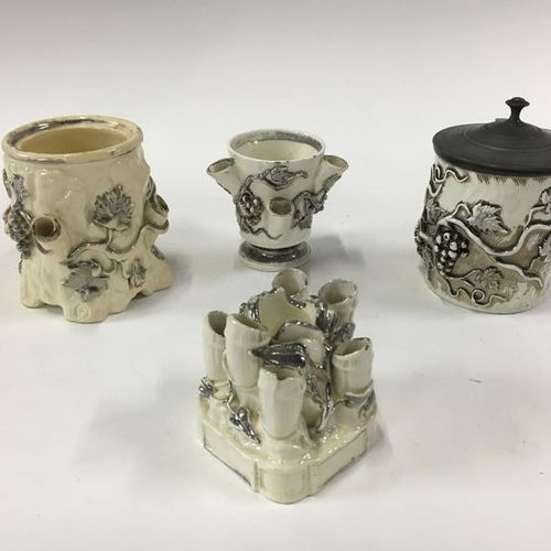 Lot including tobacco jars, pipe holders, one of which has a tin lid two with th…