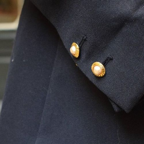 CHANEL Pair of gilded metal cufflinks with pearl cabochon  Missing a pearl
