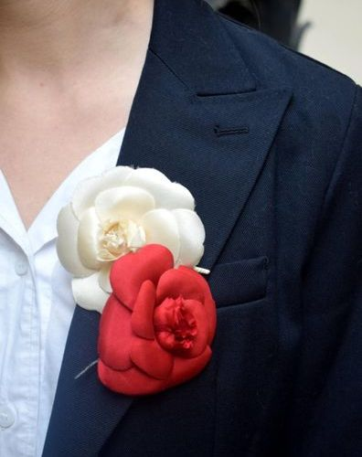 CHANEL Two silk camellia brooches Signed on plate