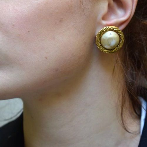 CHANEL Pair of ear clips in gold plated metal and pearl cabochon  Signed  A rugg…