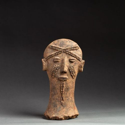 § Votive head presenting a young dignitary with chin and cheeks scarified and fo…