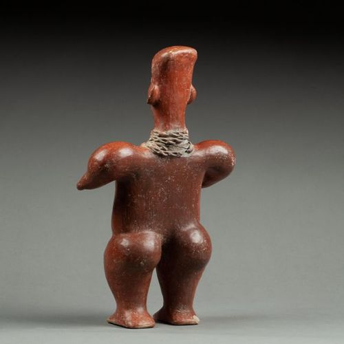 § Statuette probably showing a shaman or healer with hands symbolically pointing…