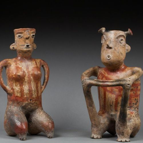 § Pair of statuettes evoking a couple in a shamanic ceremony. They display codif…