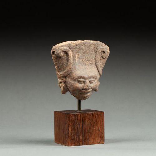 § Figurine presenting a priestess with her arms symbolically raised to the sky O…