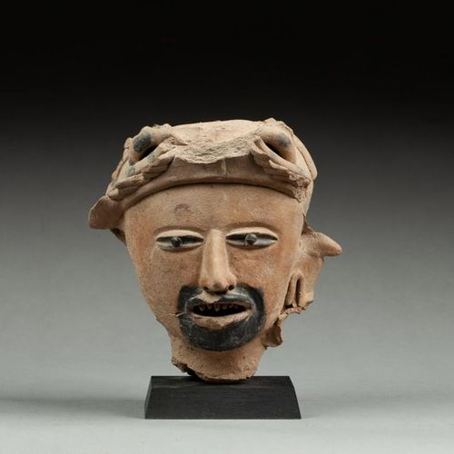 § Head of priest or warrior with mouth accompanied by body paint used during cer…