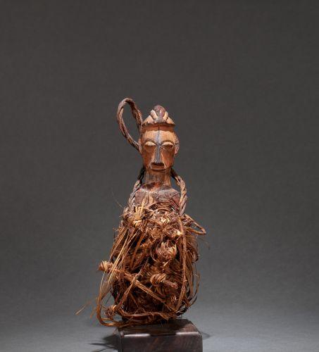 () Interesting fetish with cascading headdress  Wood, vegetable fibres, natural …