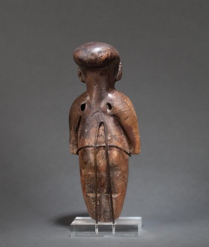 VENUS presented standing in a codified position, the body decorated with incised…