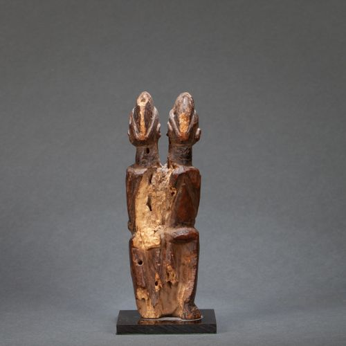 () Pair of statuettes with a symbolically oversized belly  Wood, eroded by time,…