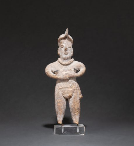 FIGURINE showing a standing shaman, wearing a loincloth held in place by a belt …
