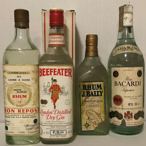 """Ensemble de 4 bouteilles dont : 1 bouteille RHUM Bally (ea) 1 bouteille RHUM """"Mo…"""