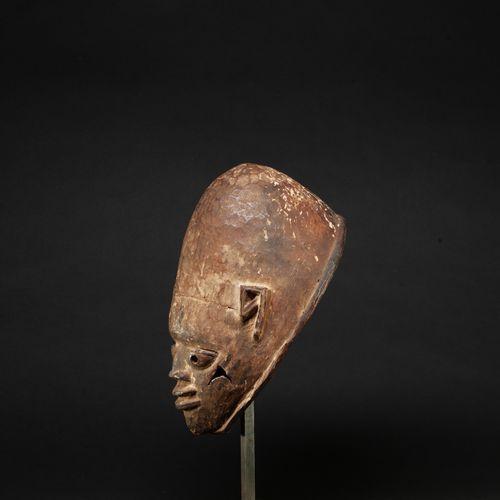 Cimier de danse guelédé carved with a juvenile face, the cheeks scarified    Woo…
