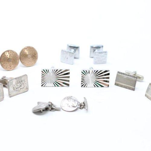 Six pairs of silver metal cufflinks.