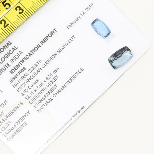 Rectangular faceted Tanzanite.  An IGI certificate dated 12/02/19 is attached.  …