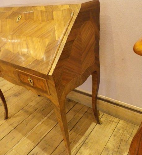 Inlaid sloping secretary, the flap uncovering five drawers (one of which is secr…