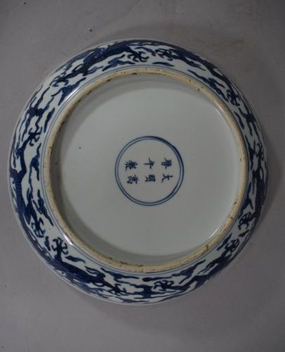 CHINA, 20th century  Porcelain plate decorated in blue under the cover of dragon…