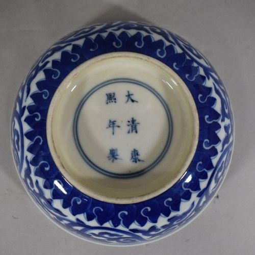 CHINA, 20th century  Porcelain bowl with flared rim decorated in blue with lotus…