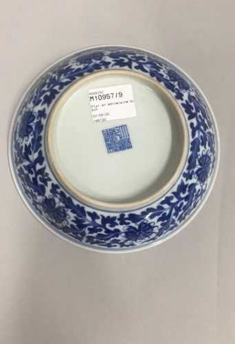 CHINA, 20th century  Porcelain plate with blue floral decoration under cover.  A…