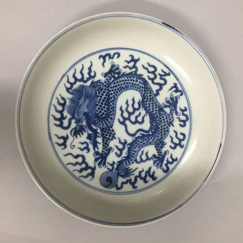 CHINA, 20th century  Porcelain plate with blue decoration under cover of a drago…