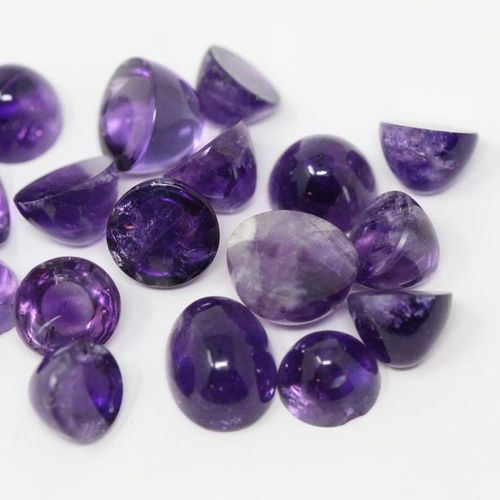 Lot of 17 cabochon amethysts.  Weight: approx. 124.75 cts