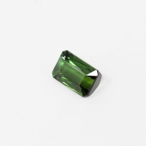 Rectangular green tourmaline with paper cut sides.  Accompanied by a GIA certifi…