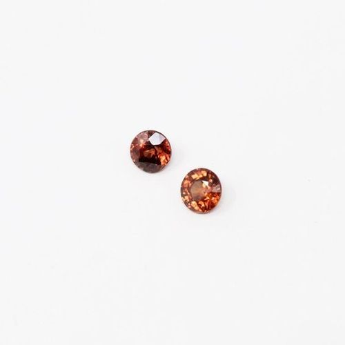 Pairing of natural cognac zircons on paper.  Weight: 2.57 cts.