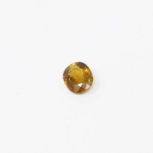 Titanite (sphene) cushion on paper.  Weight: 3.27 cts.