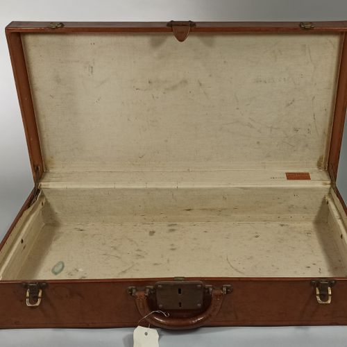 LOUIS VUITTON  Rectangular leather suitcase, push lock and solid brass hardware …