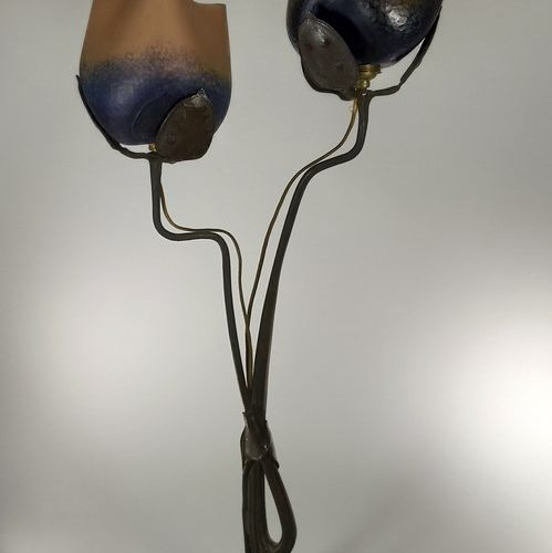 FRENCH WORK  Lamp with patinated bronze structure, bulb cover with floral body i…