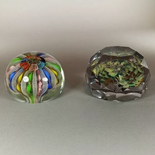 Two paperweights:   the first with a crown decoration of twelve blue, yellow, pi…