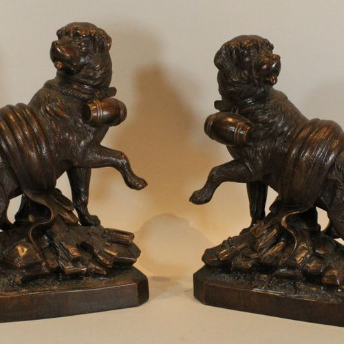 MADER Walter (attributed to)  Pair of opposite Saint Bernard dogs in carved and …
