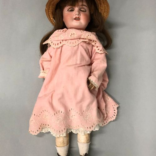 """French doll, with bisque head, closed mouth, damaged and restored, marked """"R.D"""" …"""