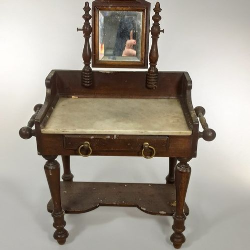 Wooden doll's dressing table, one drawer in the belt, white marble top and a piv…