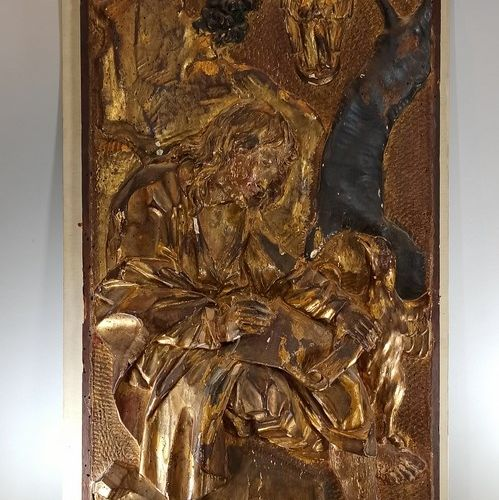 Carved and gilded wood bas relief depicting Saint John the Evangelist.  Height: …