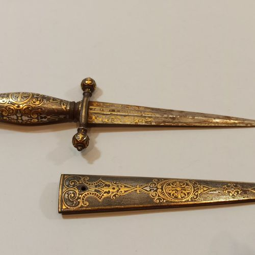 Precious iron stylus.  Pommel handle decorated with a crest, ball quillons, rock…