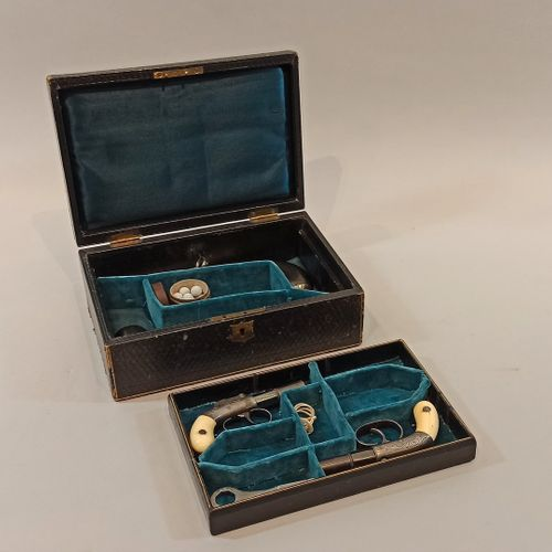 Box covered with a squared basane enclosing:  a tray with compartment covered wi…
