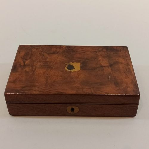 Wooden box with compartments lined with blue felt, whose lid bears the mark of W…