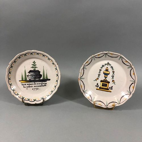 NEVERS XVIIIth CENTURY  Two plates, one of which is decorated with the tomb of M…