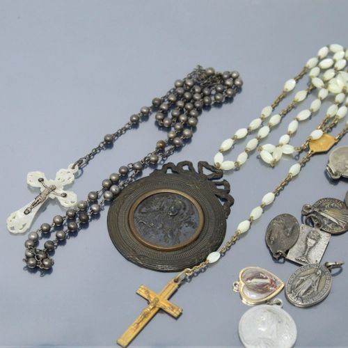 Two rosaries and a set of small religious medals.