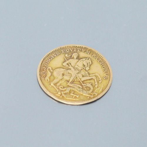 Saint George slaying the dragon medal in 18k (750) yellow gold.  Weight: 2.85 g.
