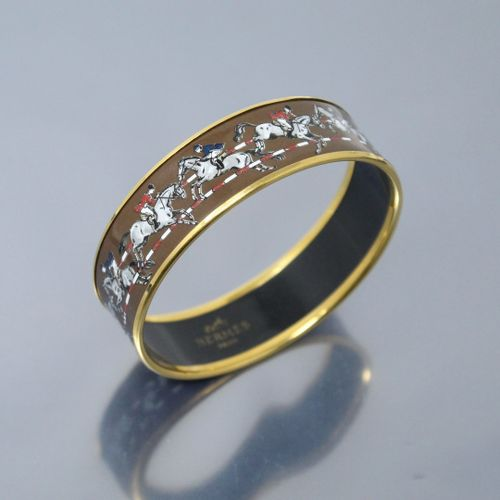 "HERMES Paris  Rigid bracelet ""Cavalier"" in gilded metal and enamelled decoration…"