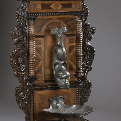 Pewter fountain with its carved wood support and native wood marquetry.  Dolphin…