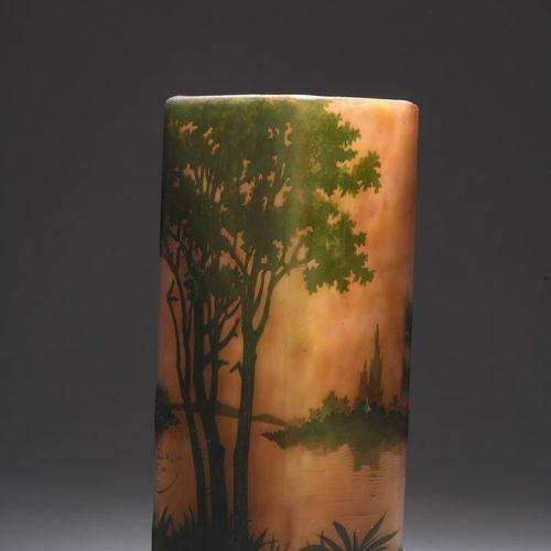 DAUM  Quadrangular vase. Green lined glass proof on orange background. Decor of …