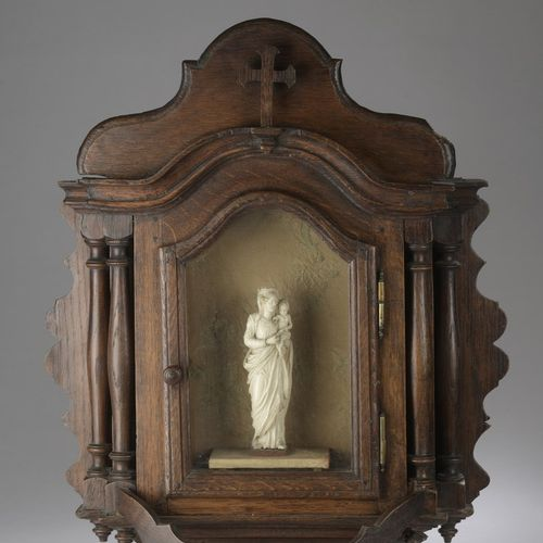 Crowned Virgin and Child in ivory carved in the round in an oak display case wit…