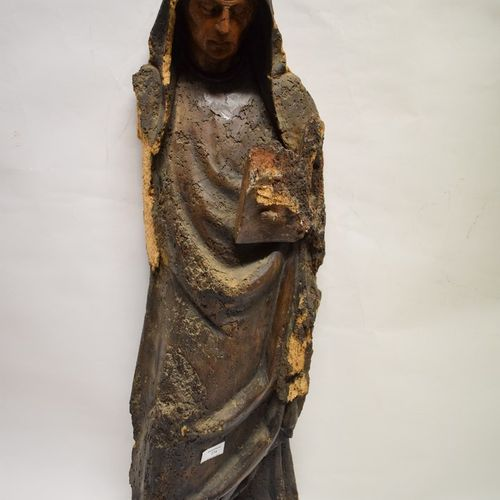 Holy woman in carved wood from the 16th century.  She is depicted standing holdi…