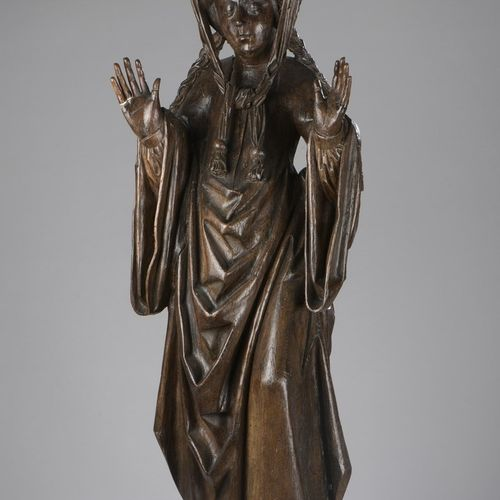 Saint Elizabeth of Hungary (?) in oak carved in the round.  She stands with her …