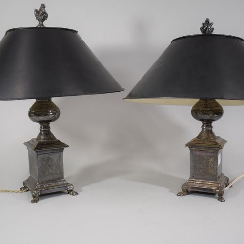 Pair of silver plated metal lamps with foliage decoration, the shafts rest on fo…
