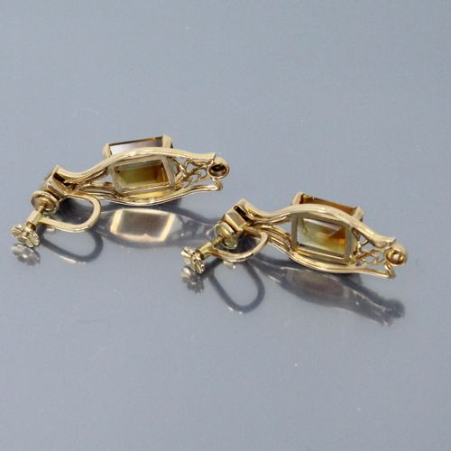 A pair of 18k (750) yellow gold earrings each set with a rectangular cut citrine…