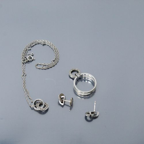 Set in 18K (750) white gold and diamonds comprising a pair of earrings, a ring a…