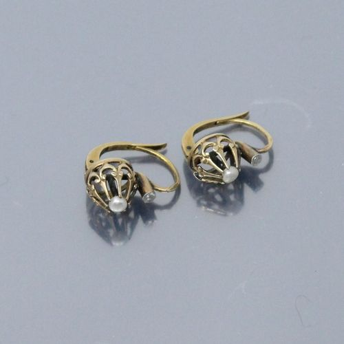 A pair of 18K (750) yellow gold earrings, each with a small pearl.  Eagle's head…