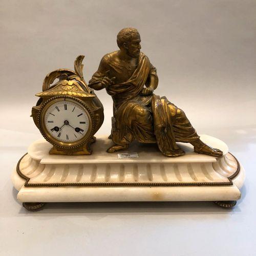 Pendule en marbre blanc et métal doré par Ph. MOUREY à décor d'un homme vétu à l…